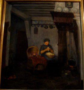 vrouw met baby schilt aardappelen (zelfde als vorige)