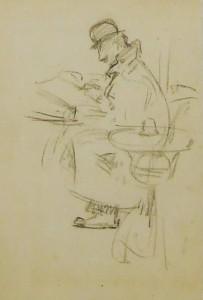 man lezend aan tafel